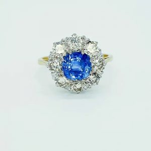 Sapphire and Diamond Cluster Ring in 18ct Gold, 1.30 carats