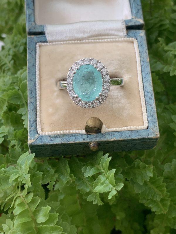 Paraiba Tourmaline and Diamond Cluster Ring in 18ct White Gold; 3.73 carat oval faceted aqua/greenish-blue Paribia tourmaline