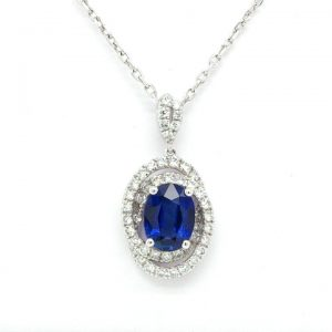 Oval Sapphire and Diamond Swirl Cluster Pendant in 18ct White Gold