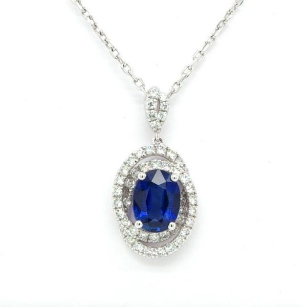 1.36ct Oval Sapphire and Diamond Swirl Cluster Pendant in 18ct White Gold