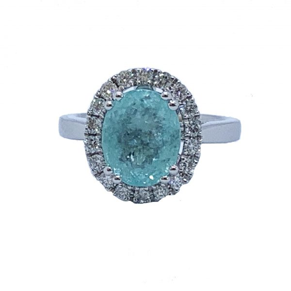 Paraiba Tourmaline and Diamond Cluster Ring in 18ct White Gold; 3.73 carat oval faceted aqua/greenish-blue Paribia tourmaline surrounded by diamonds