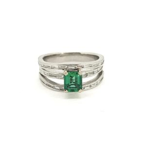 Contemporary Emerald and Diamond Three Band Ring, 0.79 carats