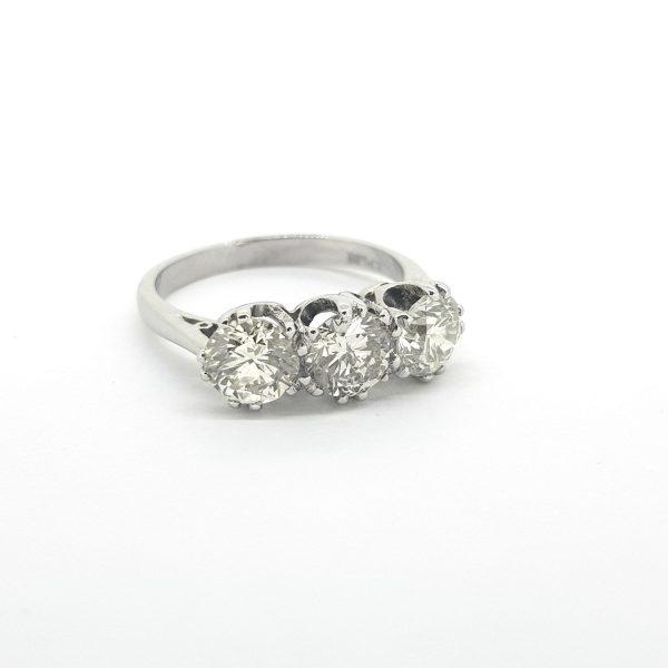 Diamond Three Stone Ring in Platinum; classic diamond trilogy ring with three round brilliant-cut diamonds totalling 2.15 carats