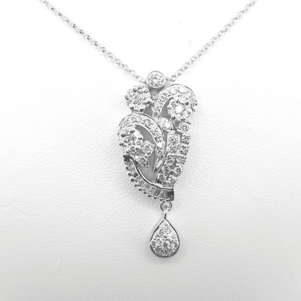 Floral Diamond Cluster Drop Pendant; diamond pendant comprised of diamond set floral clusters and swirls, in 18ct white gold, with chain