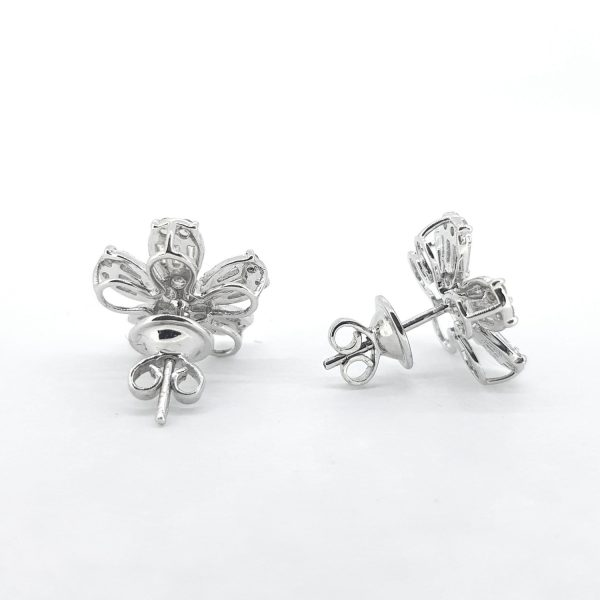 Baguette Cut Diamond Floral Cluster Earrings; set with baguette-cut diamonds with round brilliant-cut diamond accents, 1.60 carat total, in 18ct white gold