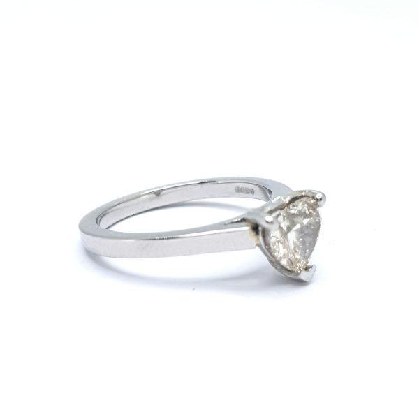 Heart Shaped Diamond Ring in Platinum; featuring a 1.06 carat heart-shaped diamond, claw set, and mounted in platinum