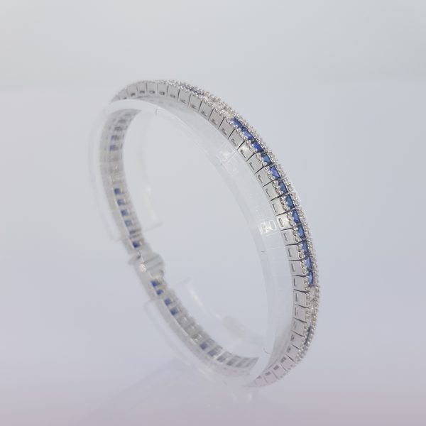 Princess Cut Sapphire and Diamond Line Bracelet in 18ct white gold. Sapphires 7.03 carats. Diamonds 2.21 carats
