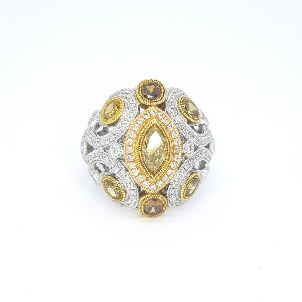 Fancy Yellow Diamond Dress Ring in 18ct White and Yellow Gold; central marquise-cut fancy yellow diamond surrounded by oval-cut and circular-cut fancy yellow diamonds, encompassed by sparkling white diamonds, 2.25 carat total
