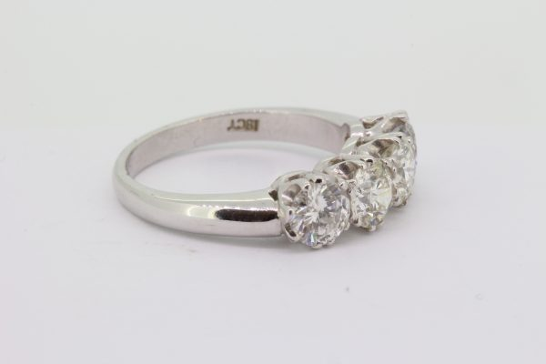 Four Stone Diamond Ring; featuring four round brilliant-cut diamonds, 2.10 carat total, claw set and mounted in 18ct white gold
