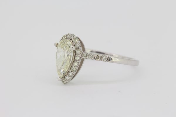 Pear Cut Diamond Cluster Ring; featuring a 1.04 carat pear-cut diamond with a 0.38ct brilliant-cut diamond surround, in 18ct white gold