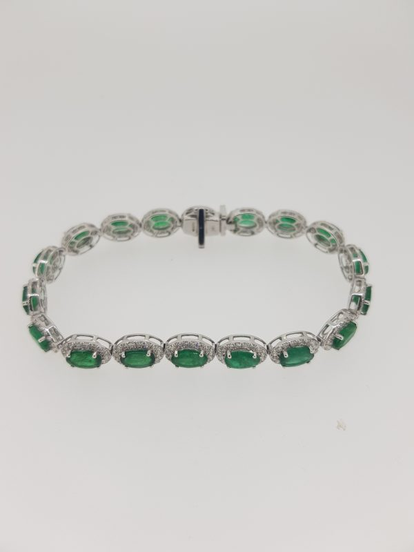 Emerald and Diamond Cluster Bracelet in 18ct white gold. Emeralds 13.00 carats. Diamonds 3.20 carats