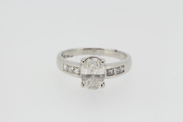 Oval Cut Diamond Engagement Ring with Princess Cut Diamond Shoulders