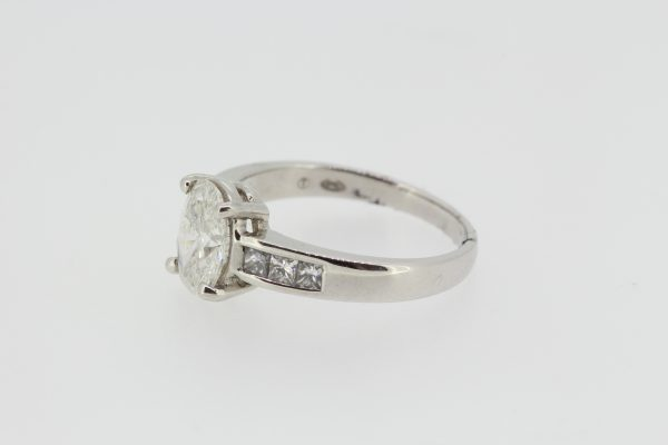 Oval Cut Diamond Engagement Ring with Princess Cut Diamond Shoulders in 18ct white gold