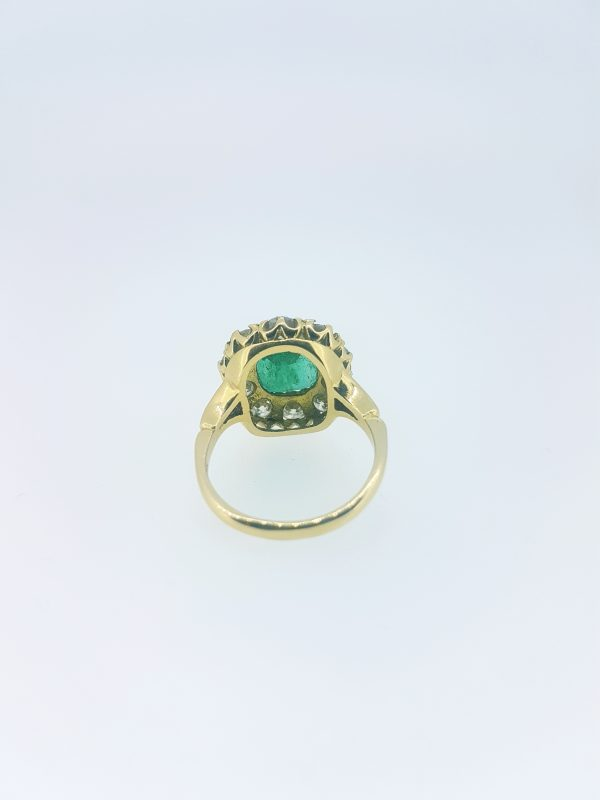 Emerald and Diamond Cluster Ring in Yellow Gold; featuring a 3.65 carat cushion-shaped emerald surrounded by 1.85cts circular cut diamonds