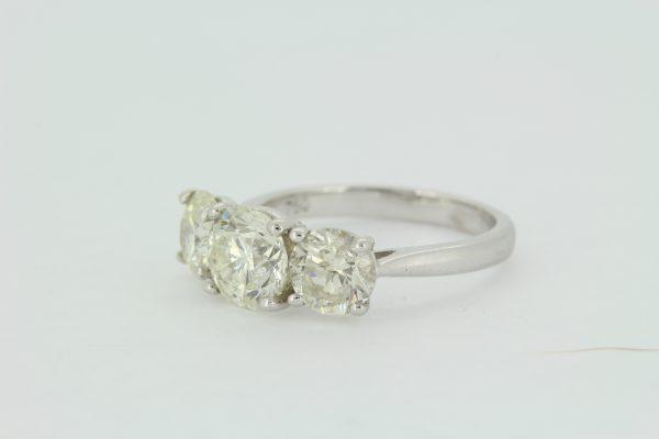 Classic Three Stone Diamond Trilogy Ring, 3.69 carat total, three round brilliant-cut diamonds, claw set to a plain 18ct white gold shank