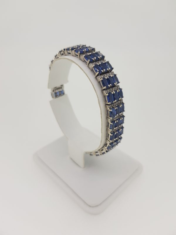 Oval Cut Sapphire and Diamond Bracelet; comprising of three rows of alternated 12.00cts oval faceted sapphires and 1.80cts diamonds, in 14ct gold