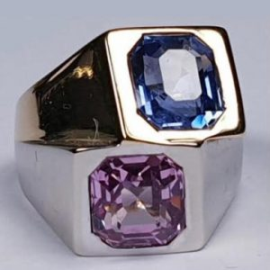 Avant Garde Pink and Blue Sapphire Two Tone Ring; striking vintage retro asymmetrical design with a natural unheated pink sapphire set in platinum and a 3ct natural unheated cornflour blue sapphire set in 18ct yellow gold. Attributed to Rene Boivin, French 1940