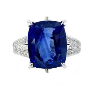 7.12ct Natural Ceylon Sapphire and Diamond Dress Ring in Platinum, by David Jerome; central 7.12 carat cushion-cut natural Sri Lanka sapphire accented with 1.30ct diamond set mount and split shoulders