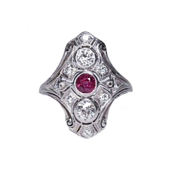 Antique Ruby and Diamond Plaque Dress Ring in Platinum; central 0.33ct ruby with a principal diamond above and below, set in a diamond-set openwork scroll design, 0.90cts total, Circa 1890