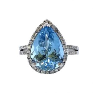 Aquamarine and Diamond Pear Shaped Cluster Cocktail Ring; 4.77 carat pear-cut aquamarine with a diamond surround, in 18ct white gold with diamond-set split shoulders