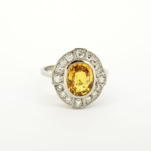 Yellow Sapphire and Diamond Oval Cluster Ring in Platinum, 2.60 carats