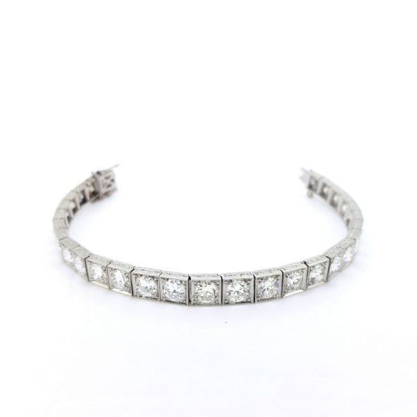 Vintage Diamond Line Bracelet in Platinum, 12.00 carat total; 29 brilliant cut diamonds mounted in square collet settings crafted in platinum