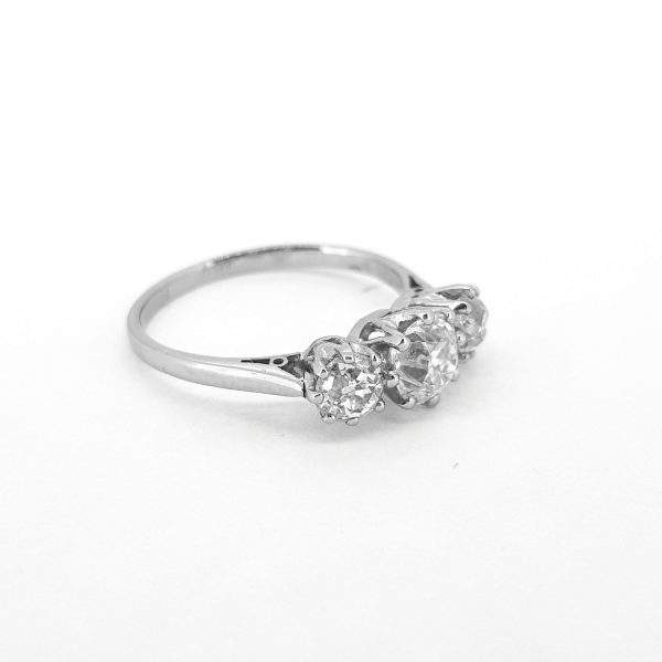 Vintage Old Cut Diamond Three Stone Ring in Platinum, 1.37 carat total, central 0.71ct old cut diamond flanked by a 0.33ct diamond either side