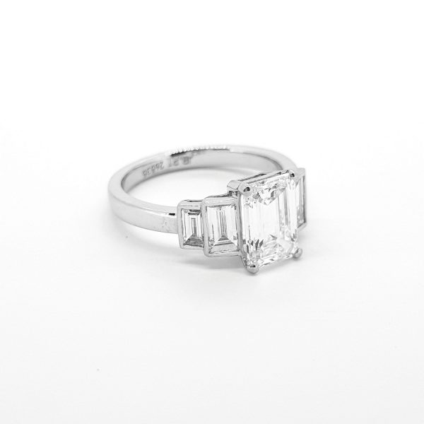 Emerald Cut Diamond Engagement Ring in Platinum; central 1.75 carat emerald-cut diamond flanked by stepped collet-set baguette-cut diamonds