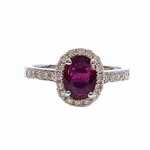 Burma Ruby and Diamond Cluster Ring; central 1.11ct oval faceted Burmese ruby with no indication of heat treatment set within a diamond halo, with diamond set shoulders, in 18ct white gold