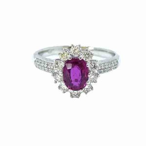 Burma Ruby and Diamond Cluster Ring in Platinum; 1.16 carat oval faceted Burmese ruby claw set within a diamond surround, with two rows of diamonds set into each shoulder