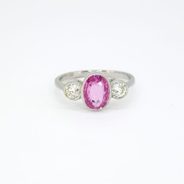 1.35ct Oval Cut Pink Sapphire and Diamond Three Stone Ring in Platinum