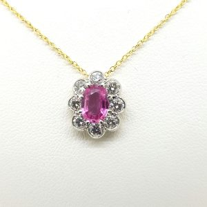 Pink Sapphire and Diamond Oval Cluster Pendant, 0.70 carats