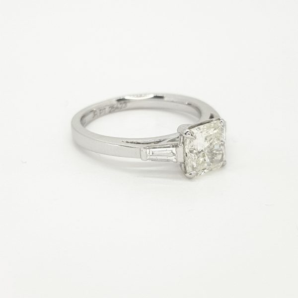 Radiant Cut Diamond Ring with Baguette Shoulders in Platinum; central 0.51 carat radiant-cut diamond flanked by 0.38cts baguette-cut diamonds to the shoulders