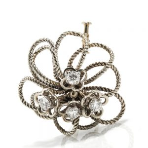 Vintage Boucheron Platinum and Diamond Floral Brooch; platinum twisted rope floral design, 4 central flowers each set with a 0.33ct brilliant-cut diamond, Circa 1950s