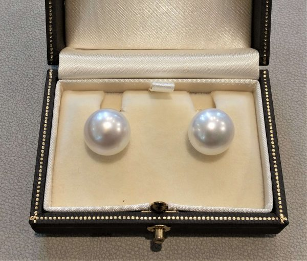 South Sea Pearl Stud Earrings, Signed Assael of New York, button shape 14mm South Sea cultured pearl earrings in 18ct yellow gold by Assael of New York