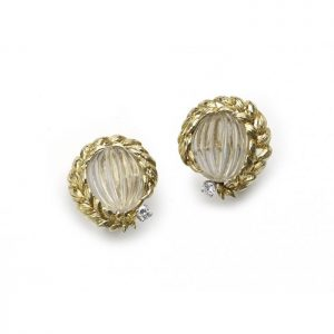 Vintage David Webb Rock Crystal, Diamond and Gold Earrings; melon cut carved rock crystal with gold leaf style garland surrounds and round brilliant-cut diamond accents, Signed, Circa 1980