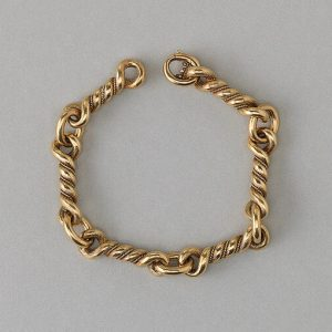 Vintage Hermes Gold Knot Bracelet; comprised of six 18ct yellow gold knotted links. Signed Hermès, Paris, Circa 1970
