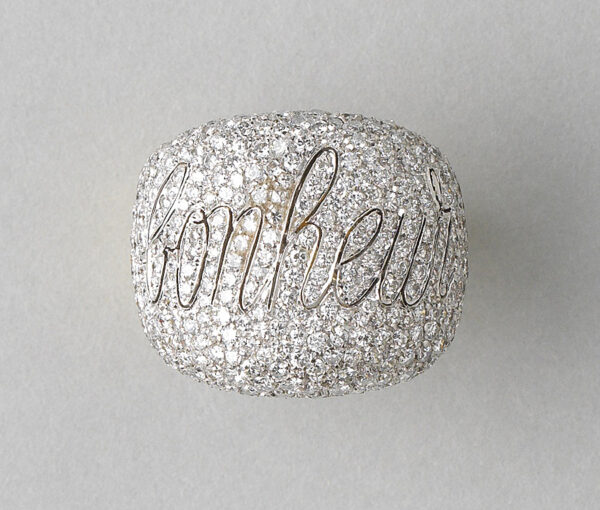 Diamond Bonheur Bombe Dress Ring; set with 4cts brilliant cut diamonds in which is graceful cursive lettering the word Bonheur, echoed inside the band in 18ct yellow gold